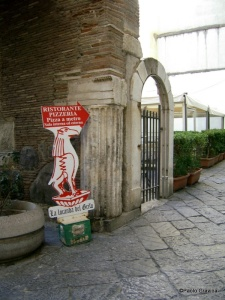 Photo 16: Naples, church of Santa Maria della Pietrasanta, bell tower, fragment of a channelled column with trabeation.