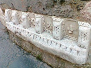 Photo 15:  Naples, church of Santa Maria della Pietrasanta, bell tower, architetural frieze from a Roman building.