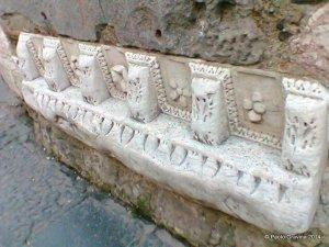 Photo 15:  Naples, church of Santa Maria della Pietrasanta, bell tower, architetural frieze from a Roman building.